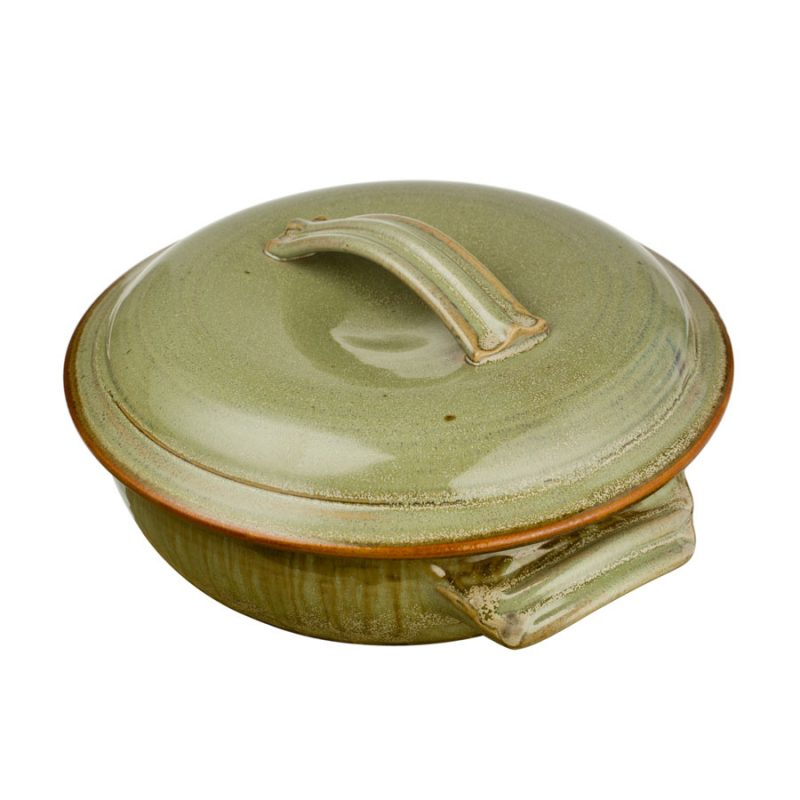a large, mint green baking dish with handles and a lid