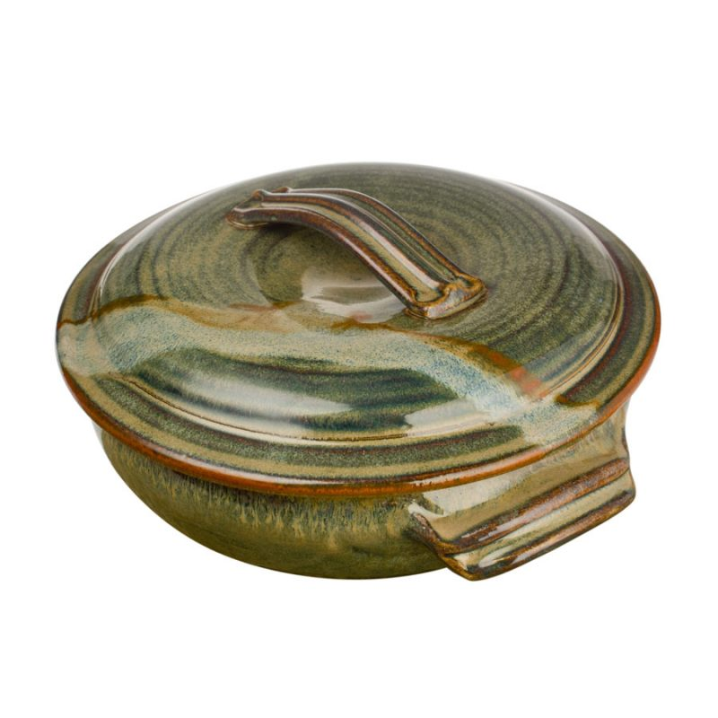 a large, green baking dish with handles and a lid