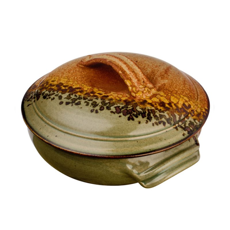 a large, green and sandy brown baking dish lid, handles,