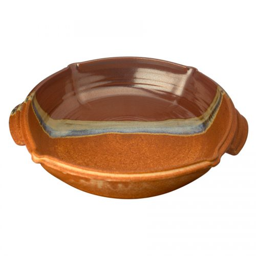 a large, red and sandy brown square baking dish with handles