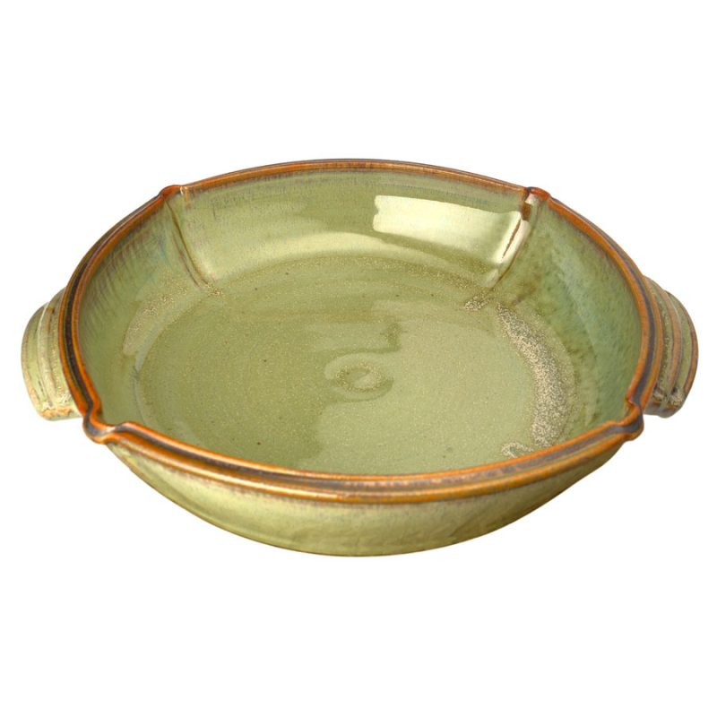 a large, mint green square baking dish with handles