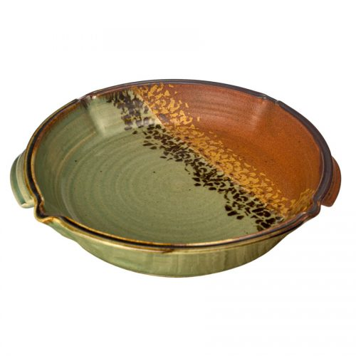 a large, green and sandy brown square baking dish with handles
