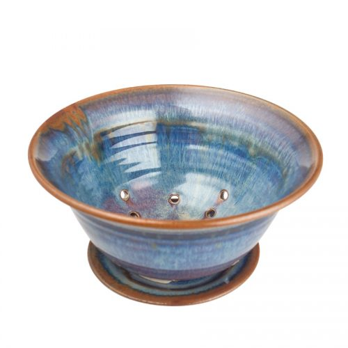 a small, blue colander and saucer set