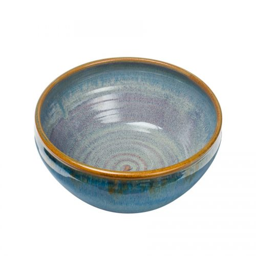 a deep, blue serving bowl with rounded sides