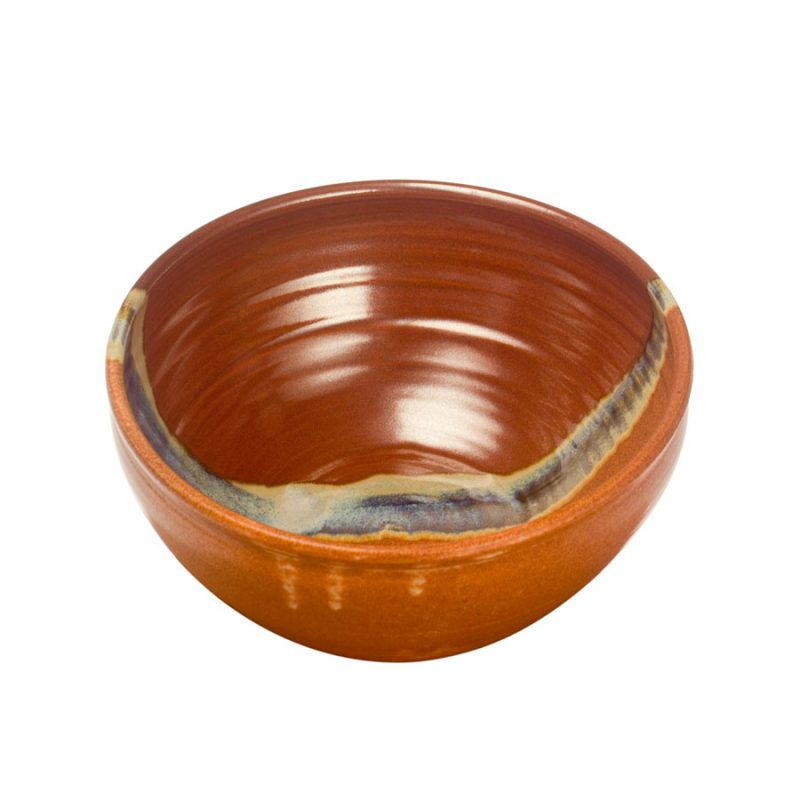 a deep, red and sandy brown serving bowl with rounded sides
