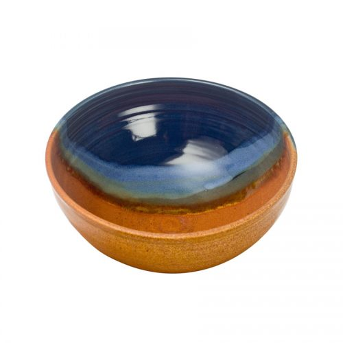 a deep, blue and sandy brown serving bowl with rounded sides