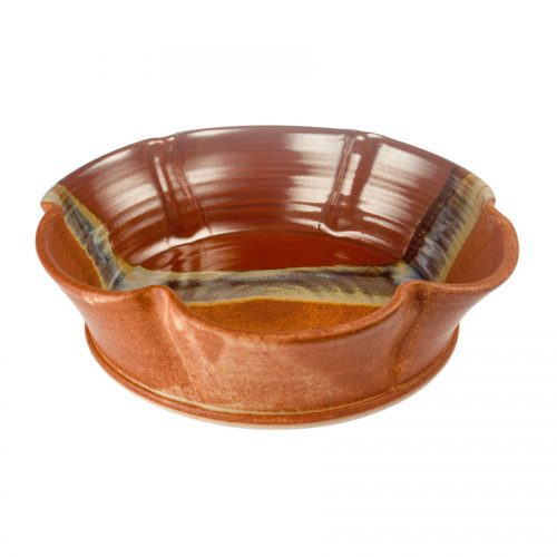 a fluted, red and sandy brown decorative bowl