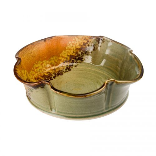 a fluted, green and sandy brown decorative bowl