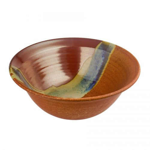 a large, red and sandy brown serving bowl