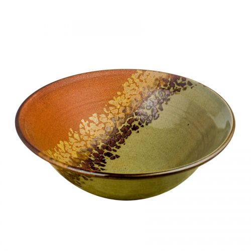 a large, green and sandy brown serving bowl