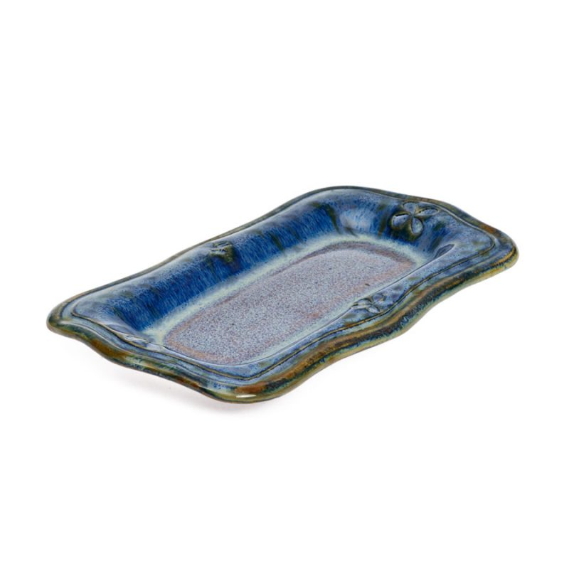a small, blue recantgular butter serving dish
