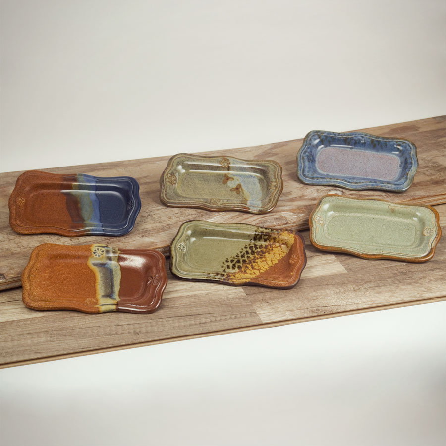 Group shot of butter trays in 6 different patterns.