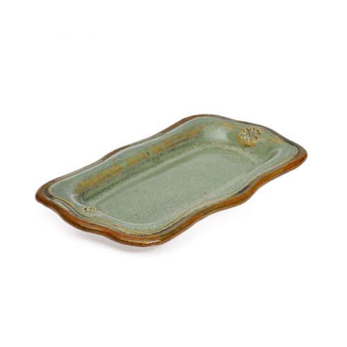 a small, mint green recantgular butter serving dish