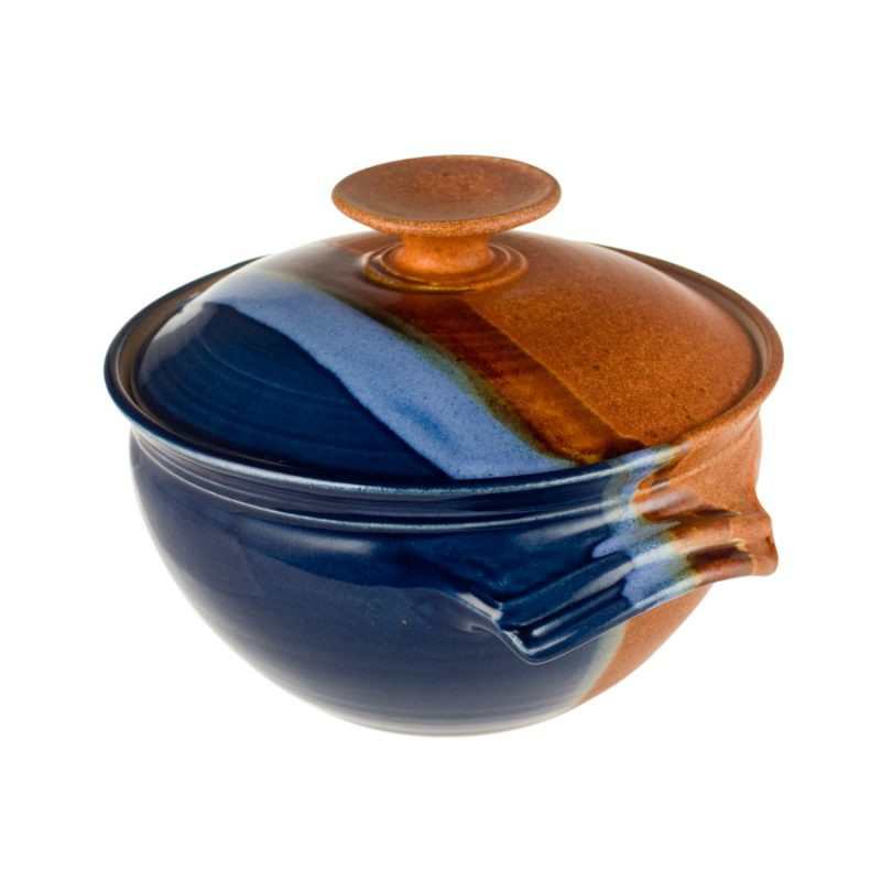 a deep, blue and sandy brown casserole baking dish with a lid