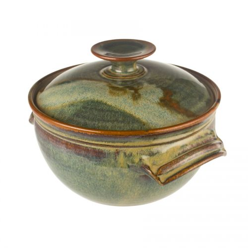 a deep, green casserole baking dish with a lid