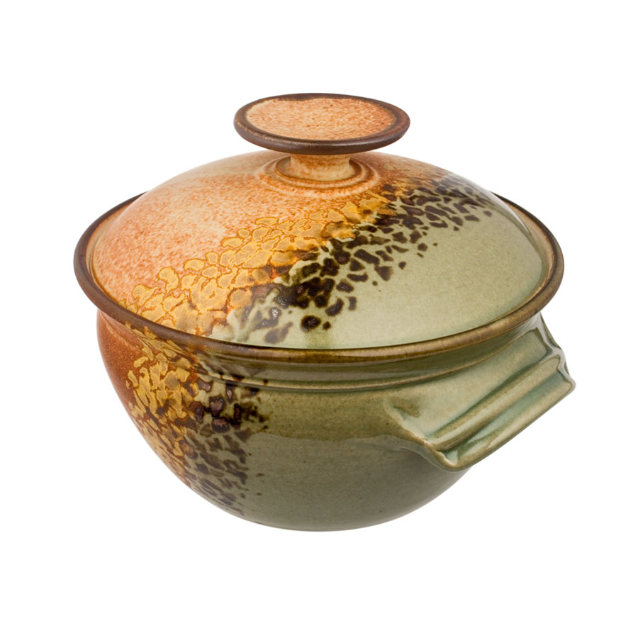 a deep, green and sandy brown casserole baking dish with a lid
