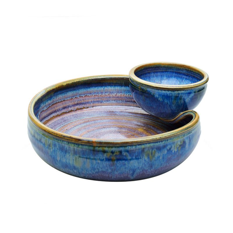 a shallow, blue serving dish with an attached bowl