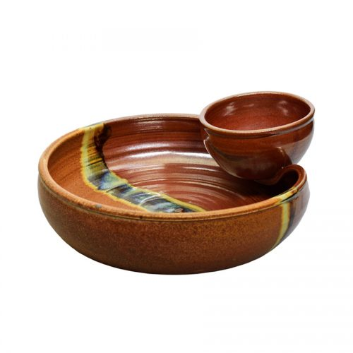 a shallow, red and sandy brown serving dish with an attached bowl
