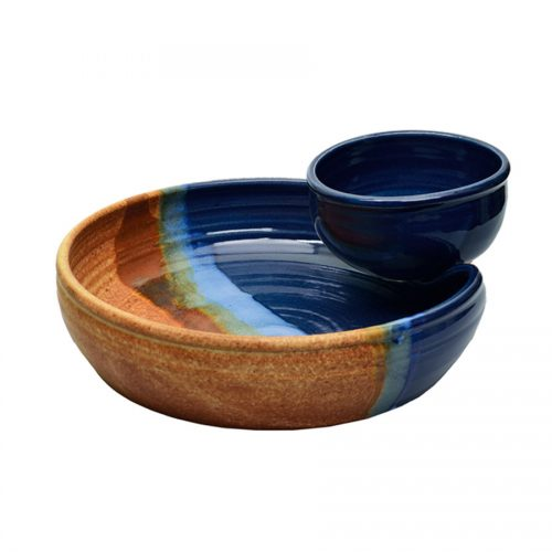 a shallow, blue and sandy brown serving dish with an attached bowl