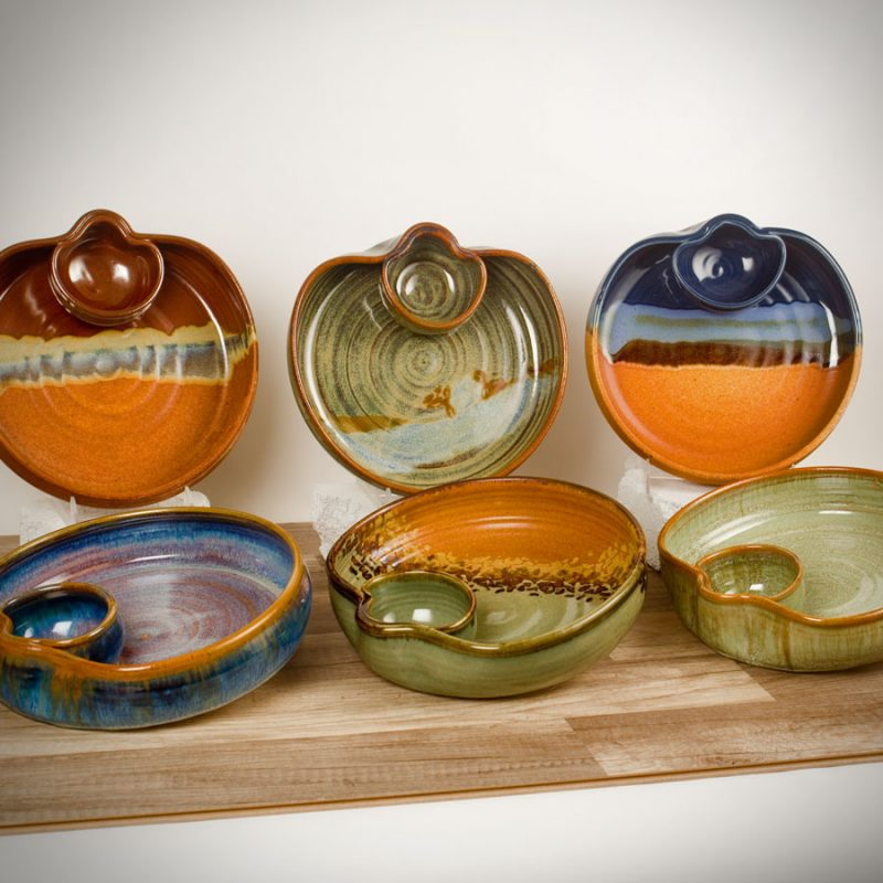 6 shallow serving bowls with attached bowls in assorted patterns.