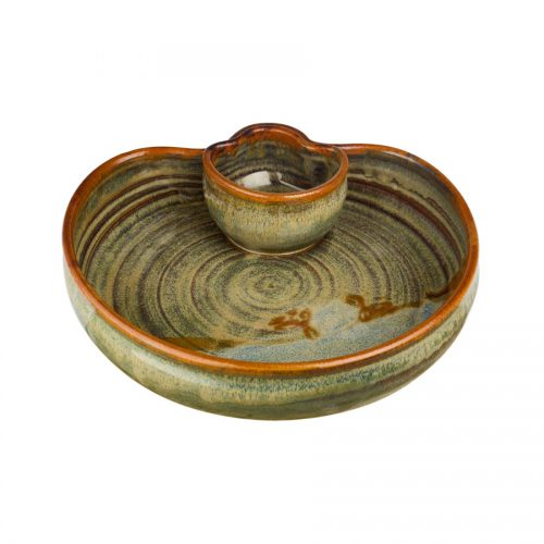 a small, green serving dish with an attached bowl