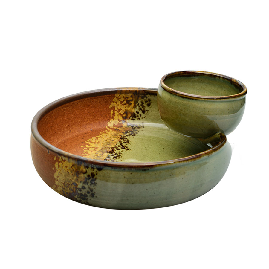a shallow, green and sandy brown serving dish with an attached bowl