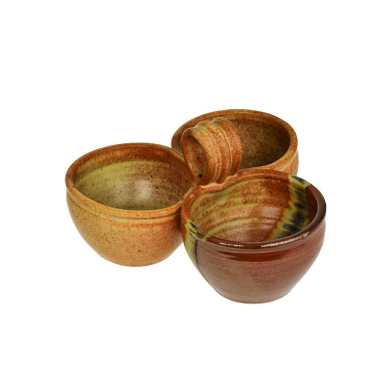 a red and sandy brown condiment dish with 3 bowls and a handle