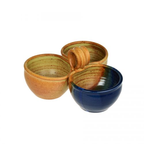 a blue and sandy brown condiment dish with 3 bowls and a handle