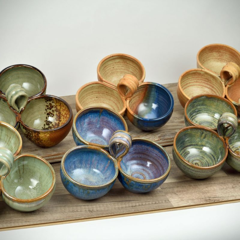 6, 3-bowl serving dishes with handles, in different patterns.