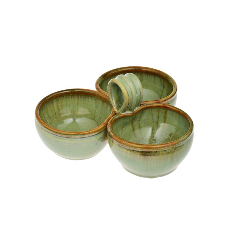 a mint green condiment dish with 3 bowls and a handle