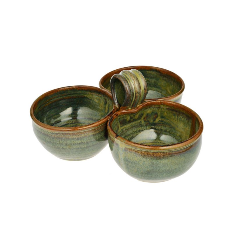 a shallow, green serving dish with an attached bowl