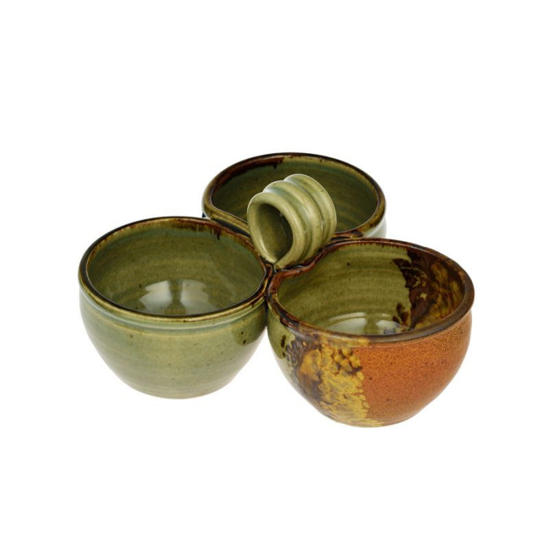 a green and sandy brown condiment dish with 3 bowls and a handle
