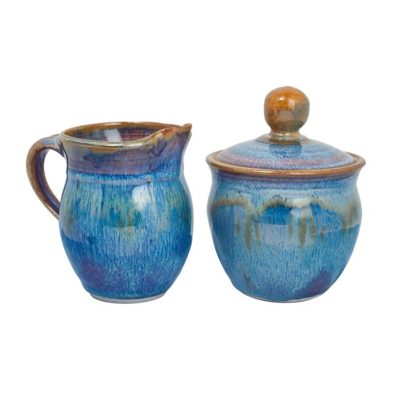 a small, blue cream pitcher and sugar jar set