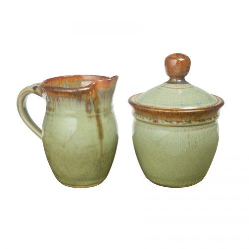 a small, mint green cream pitcher and sugar jar set
