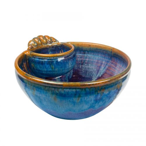 a large, blue serving bowl with an attached cup and handle