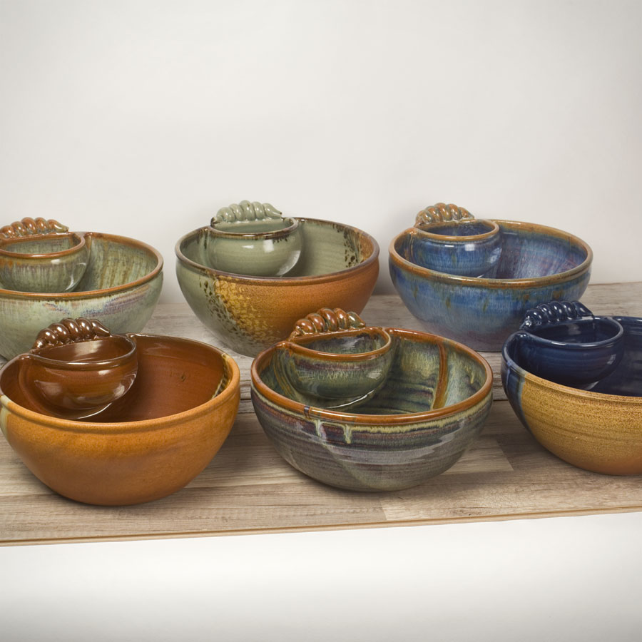 6 large, serving bowls with attached cups and handles, in different patterns.
