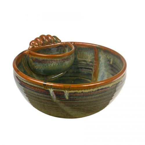 a large, green serving bowl with an attached cup and handle