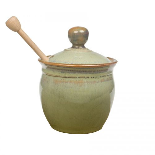 a small, mint green kitchen storage container with a lid