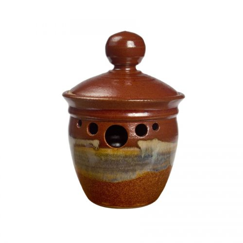 a small, red and sandy brown kitchen storage container with a lid