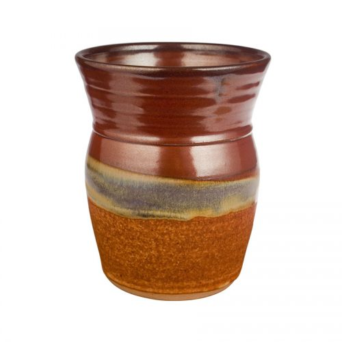 a tall, red and sandy brown storage jar