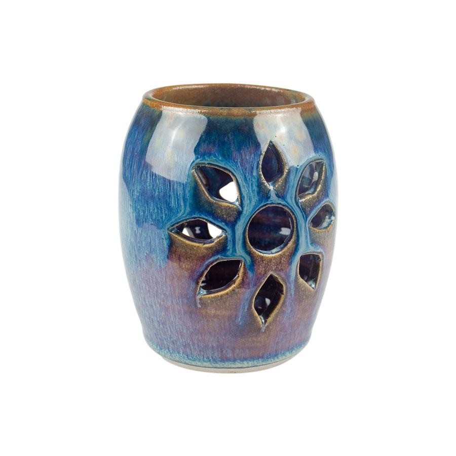 a decorative, blue votive candle holder
