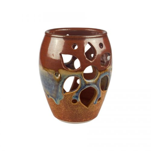 a decorative, red and sandy brown votive candle holder