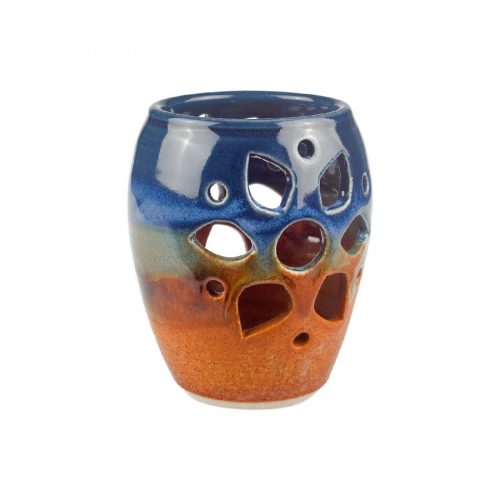 a decorative, blue and sandy brown votive candle holder