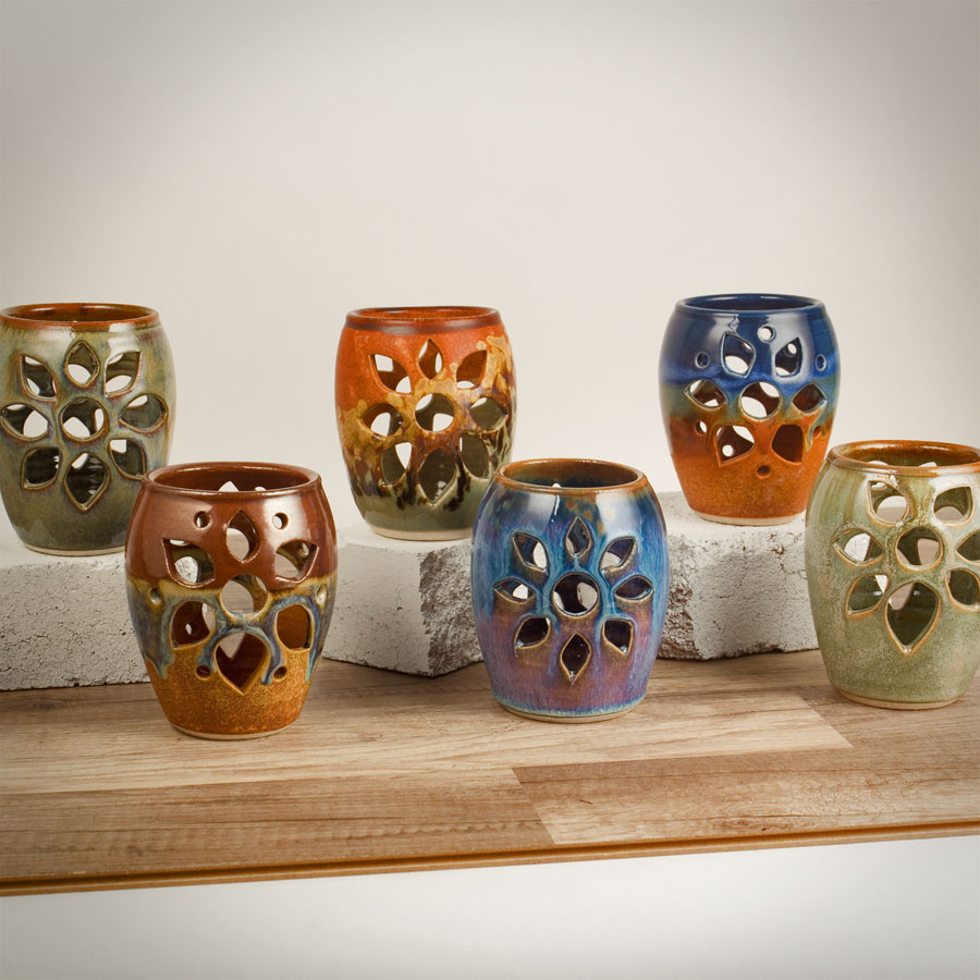 6 decorative votive candle holders in assorted patterns