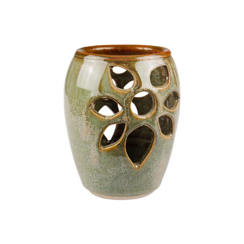 a decorative, mint green votive candle holder