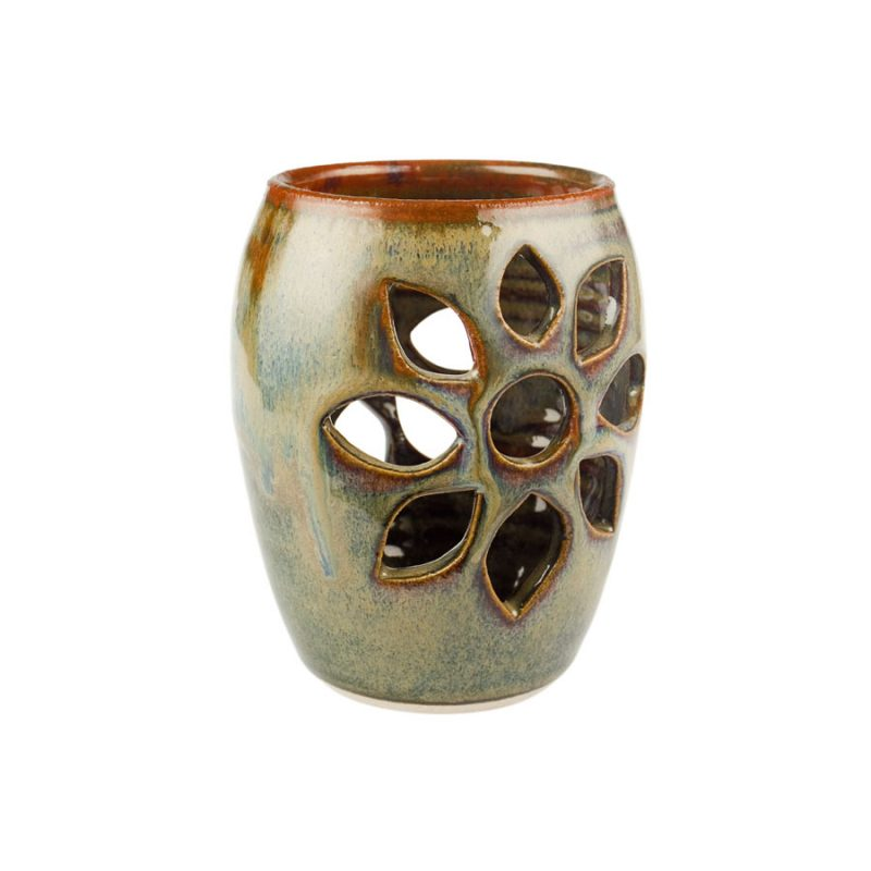 a decorative, green votive candle holder