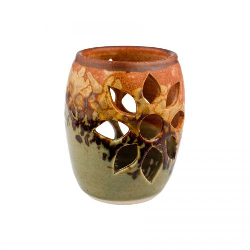 a decorative, green and sandy brown votive candle holder