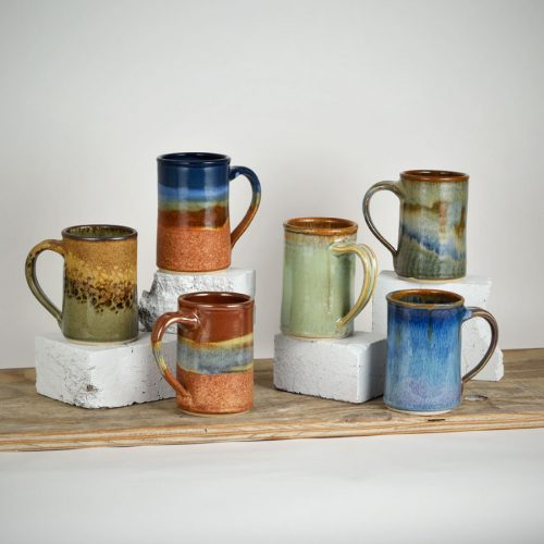 6 coffee mugs with straight sides, in assorted patterns.