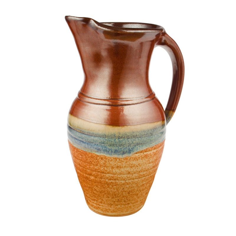 a tall, red and sandy brown pitcher with a handle