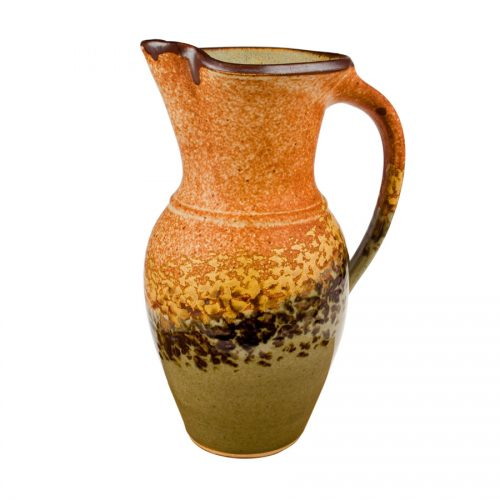 a tall, green and sandy brown pitcher handle